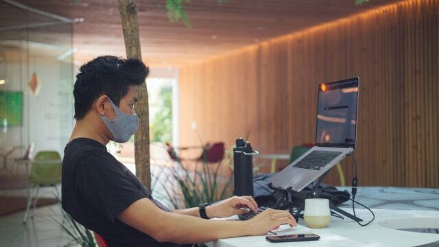 Remote worker with a face mask.