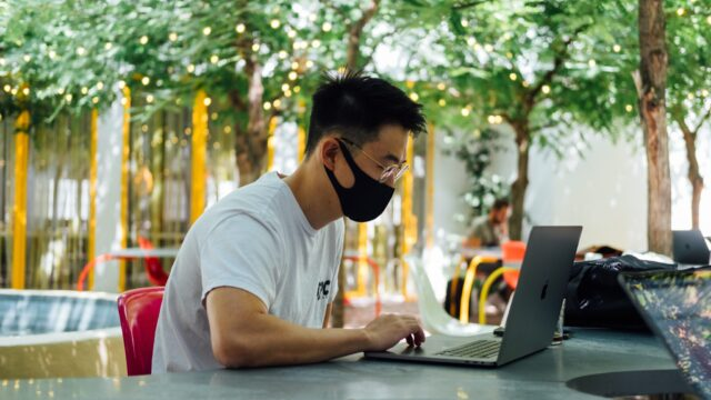 Remote worker working on laptop.