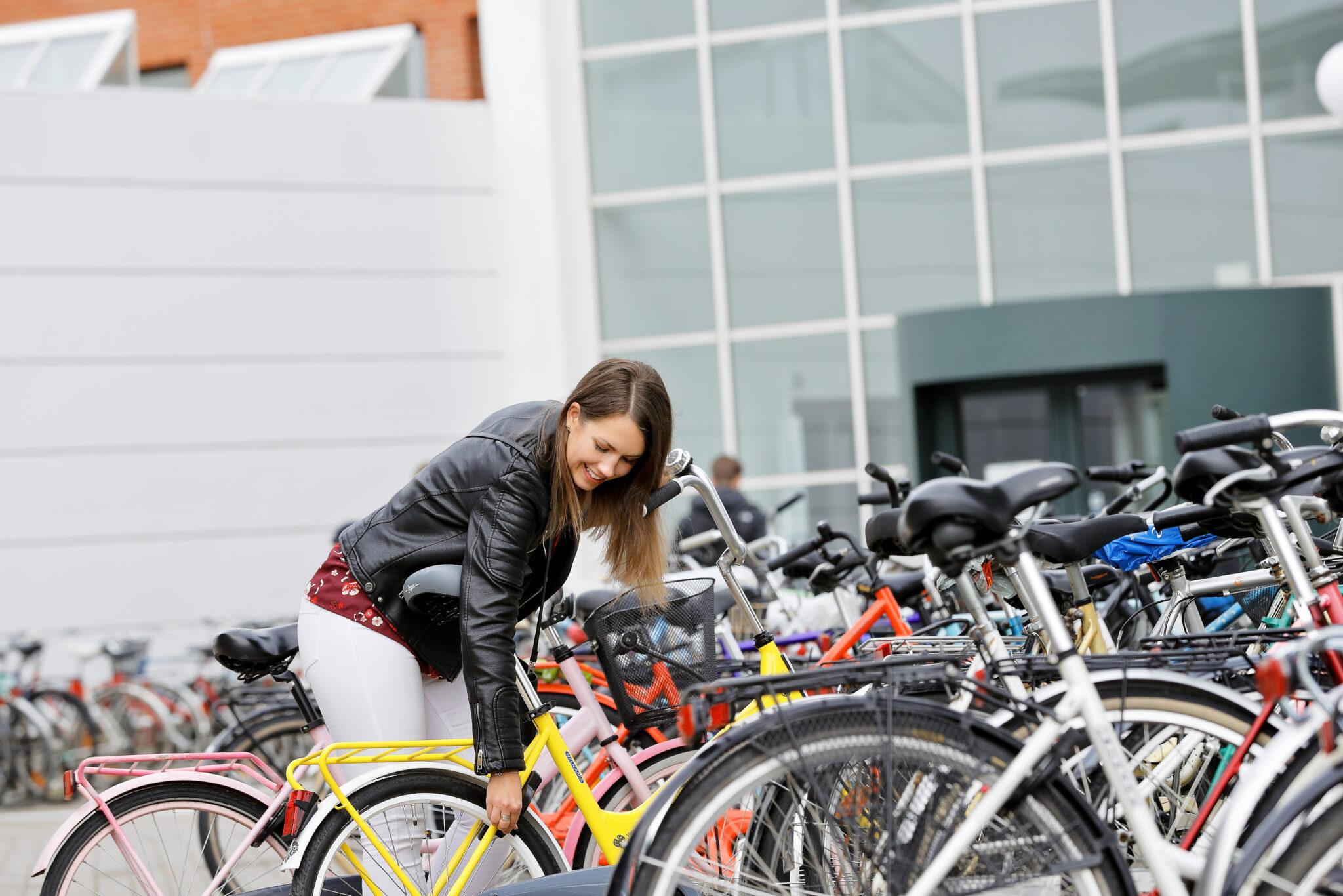 a girl locks her bike